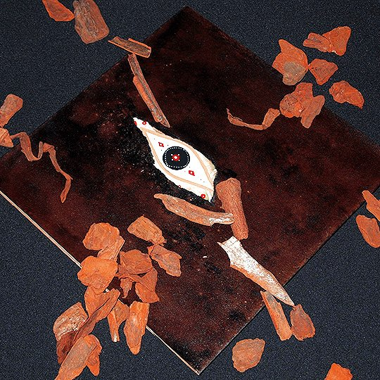 ...which is all housed inside this hand-painted tri-fold outer sleeve with real cinnamon-based inks and fragments.